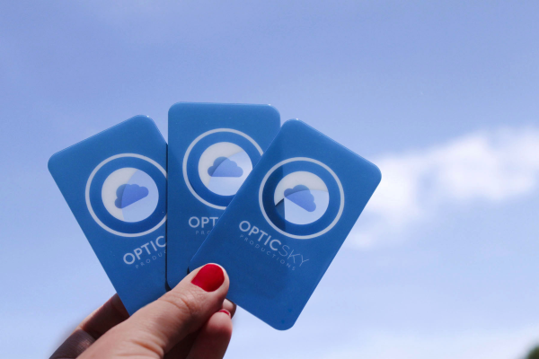 Photo of plastic business cards held against the sky - see through and opaque elements