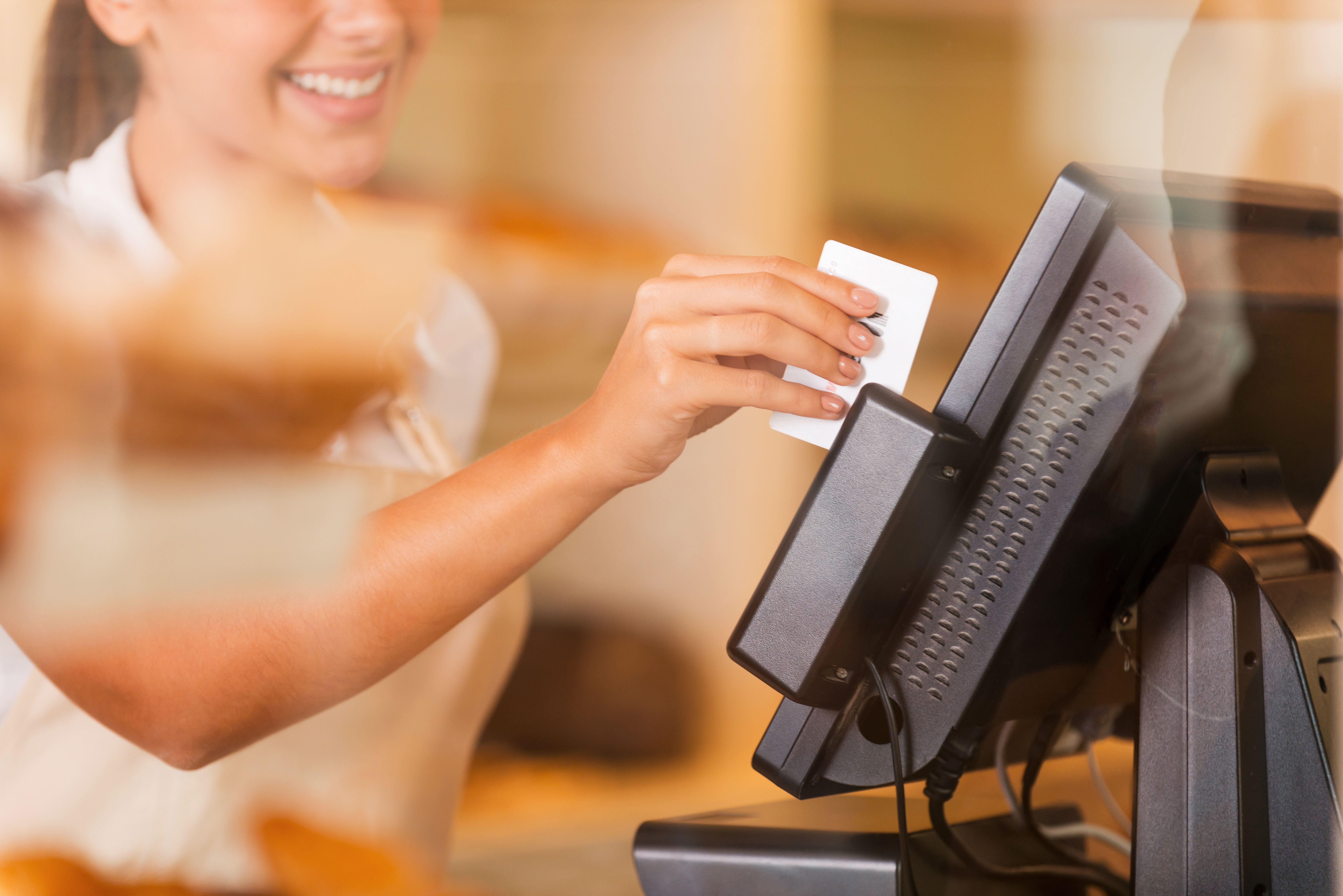 swiping credit card on cash register