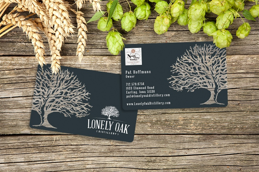 Clear business cards with a clear logo for a distillery