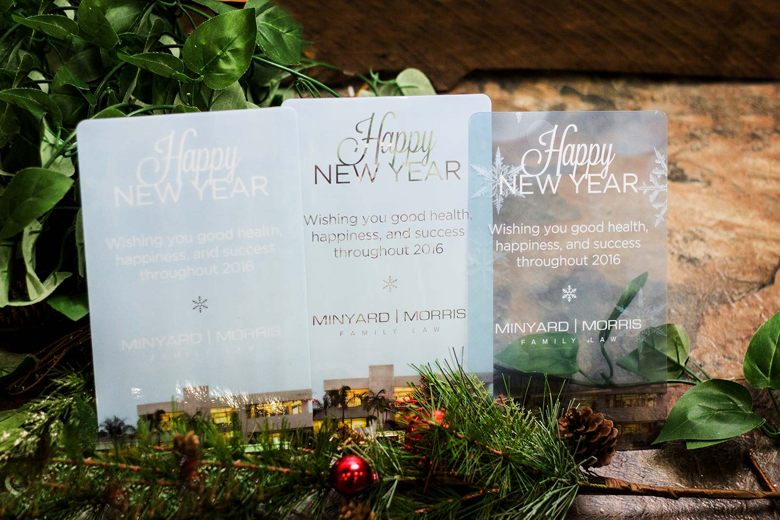 Example of 3 corporate holiday cards. Clear and transparent greeting cards for your clients, logo can be incorporated created by Plastic Printers, Inc.