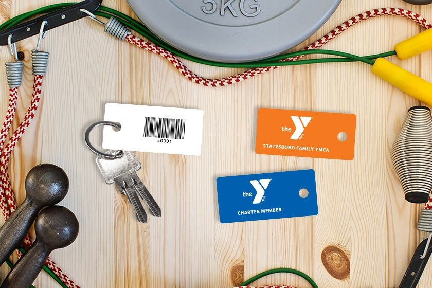 Gym membership key tags with a barcode for the YMCA