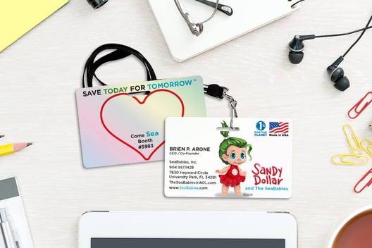 Example of Platinum Mirror-Like Reflective Custom Trade Show Badge for Sandy Dollar and the Sea Babies Cartoon