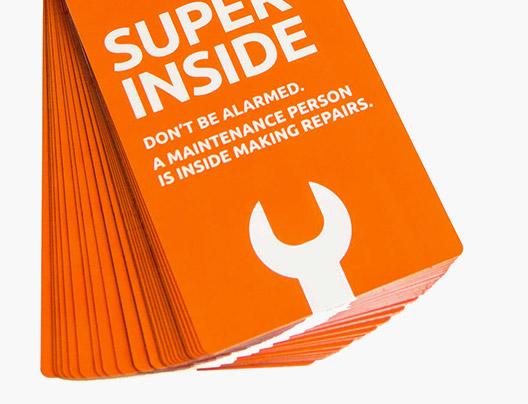Example of Safety Warning Door Hangers by PlasticPrinters.com