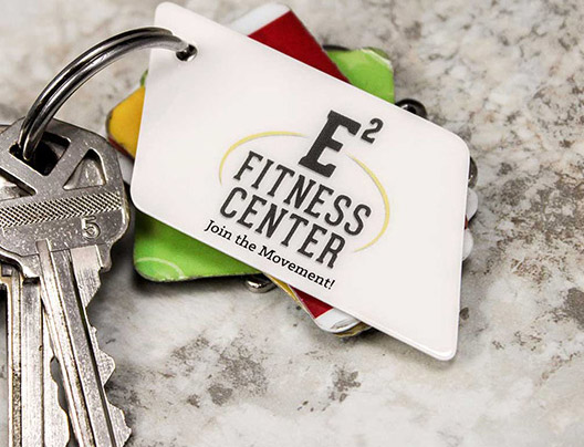 Example of custom shaped key tags for fitness center
