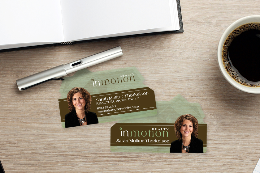 Transparent business cards in the shape of a house for a realtor