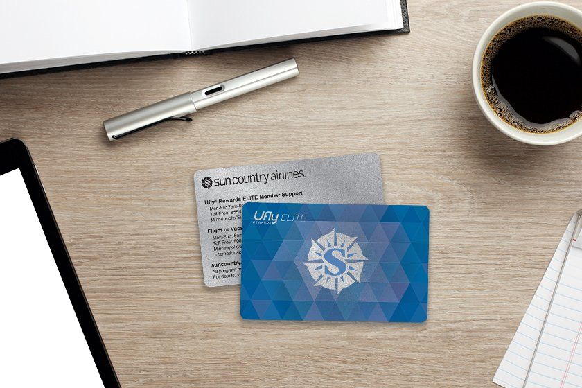 Airline rewards card with metallic elements