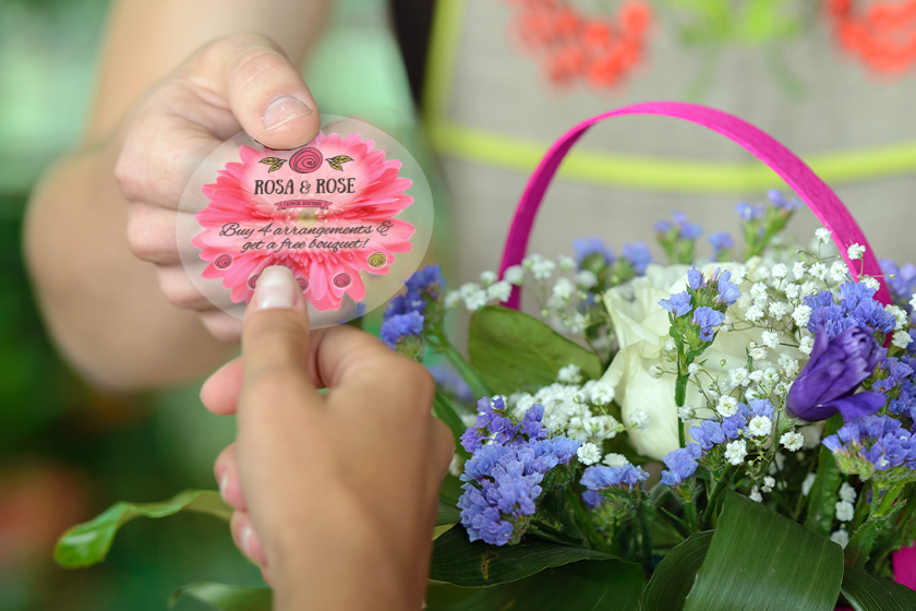 Punch cards with a floral design for a floral shop