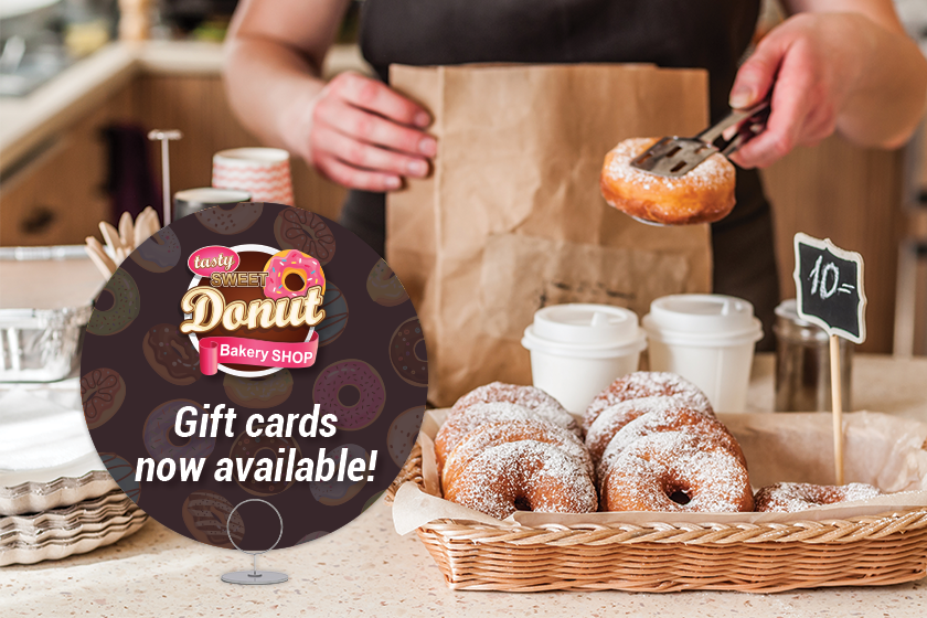 Custom signage advertising your gift cards is an important step in how to sell more gift cards