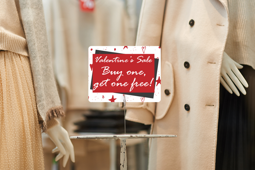 Custom signage advertising a Valentine's Day sale