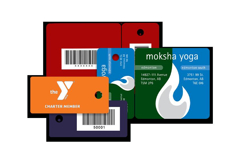 Moksha Yoga and YMCA membership key tags with unique barcodes.