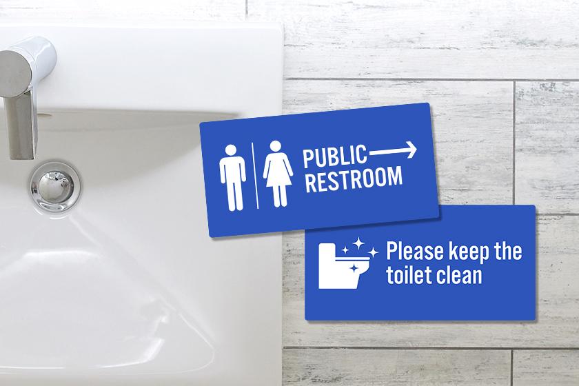 Custom plastic signs for a public bathroom