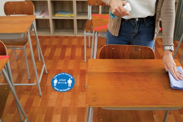 Social distancing floor decals for a school